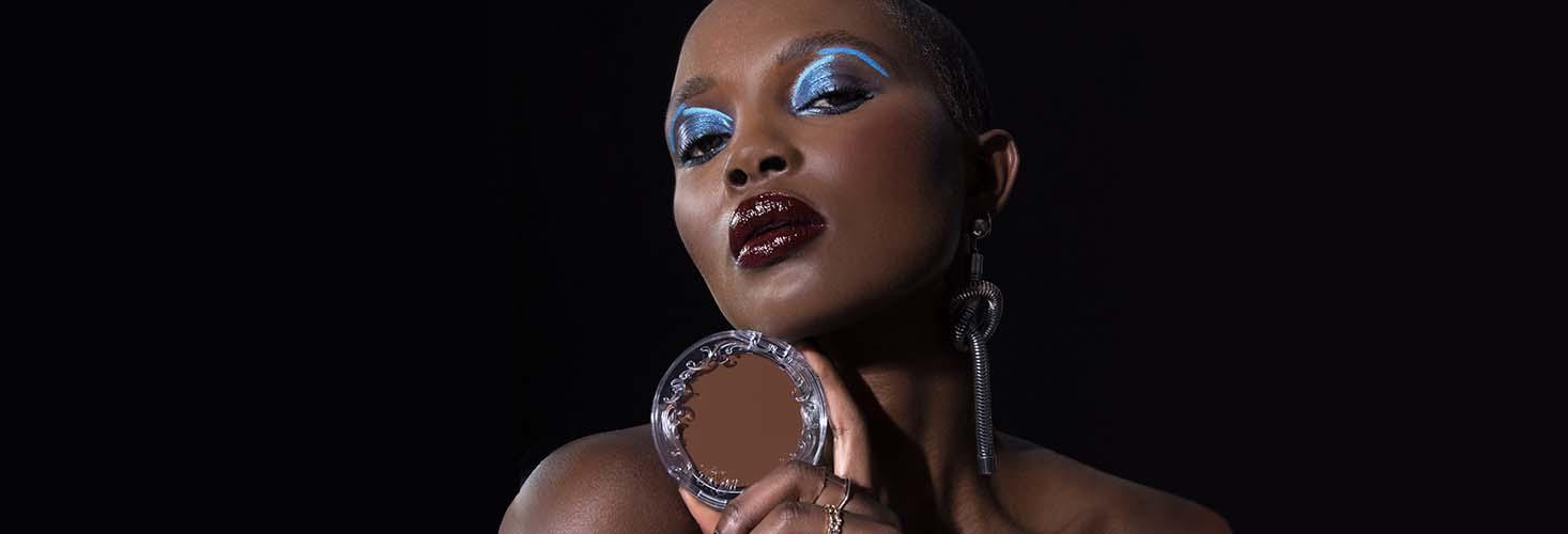 Model holding Good Apple Skin-Perfecting Foundation Balm
